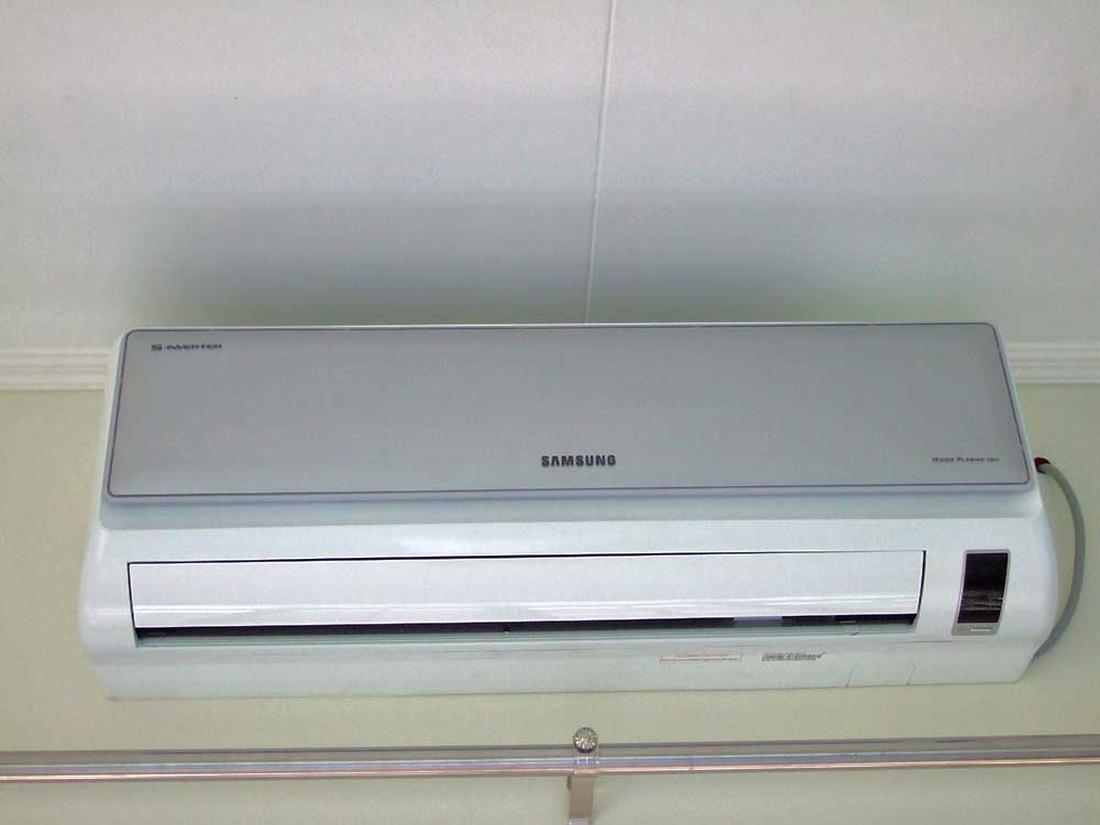 Split air con inside unit over window, at ceiling