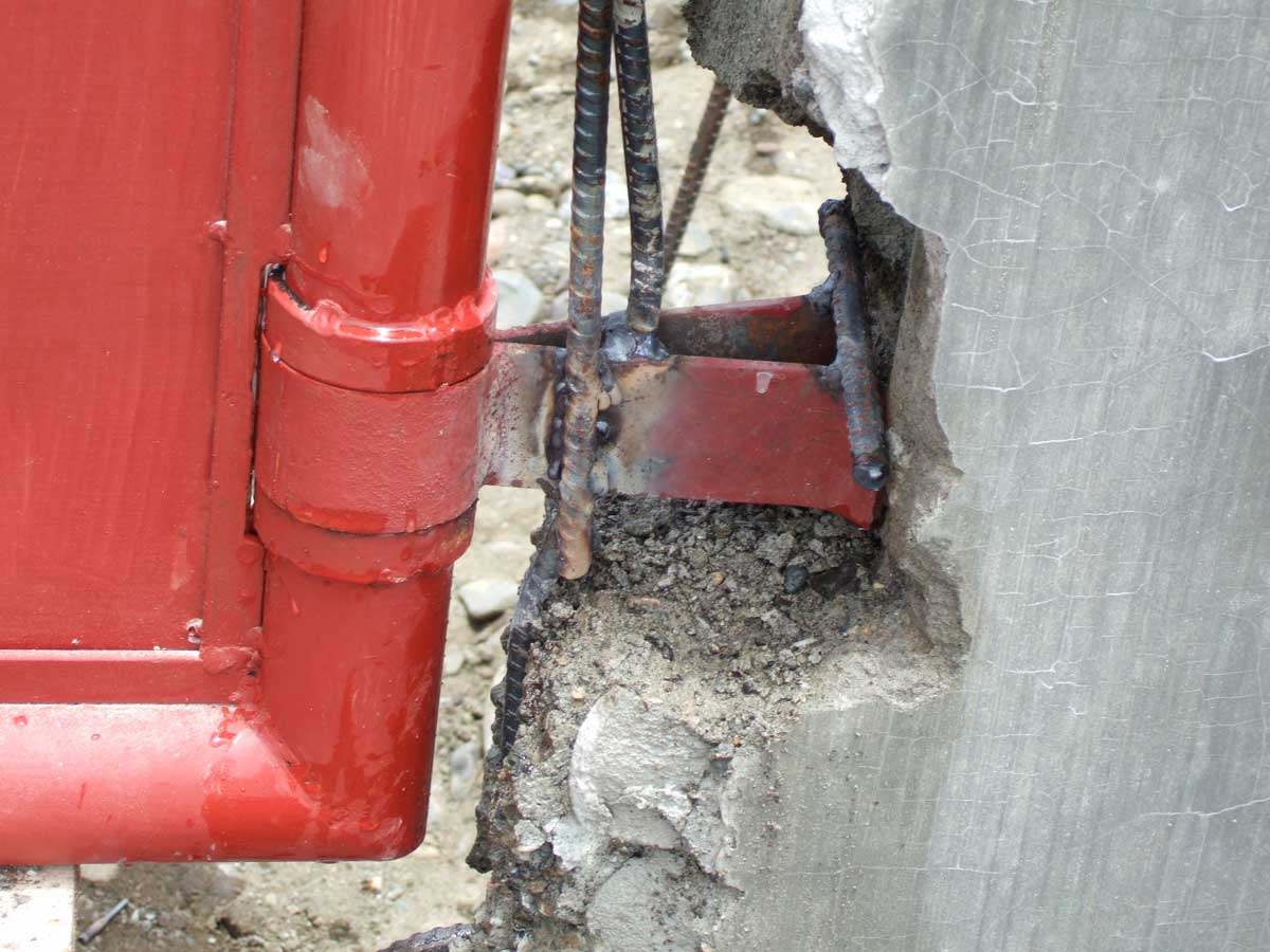 Gate hinges welded to rebar in posts.