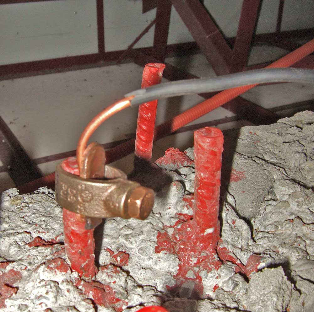 Rebar grounding clamp in attic.