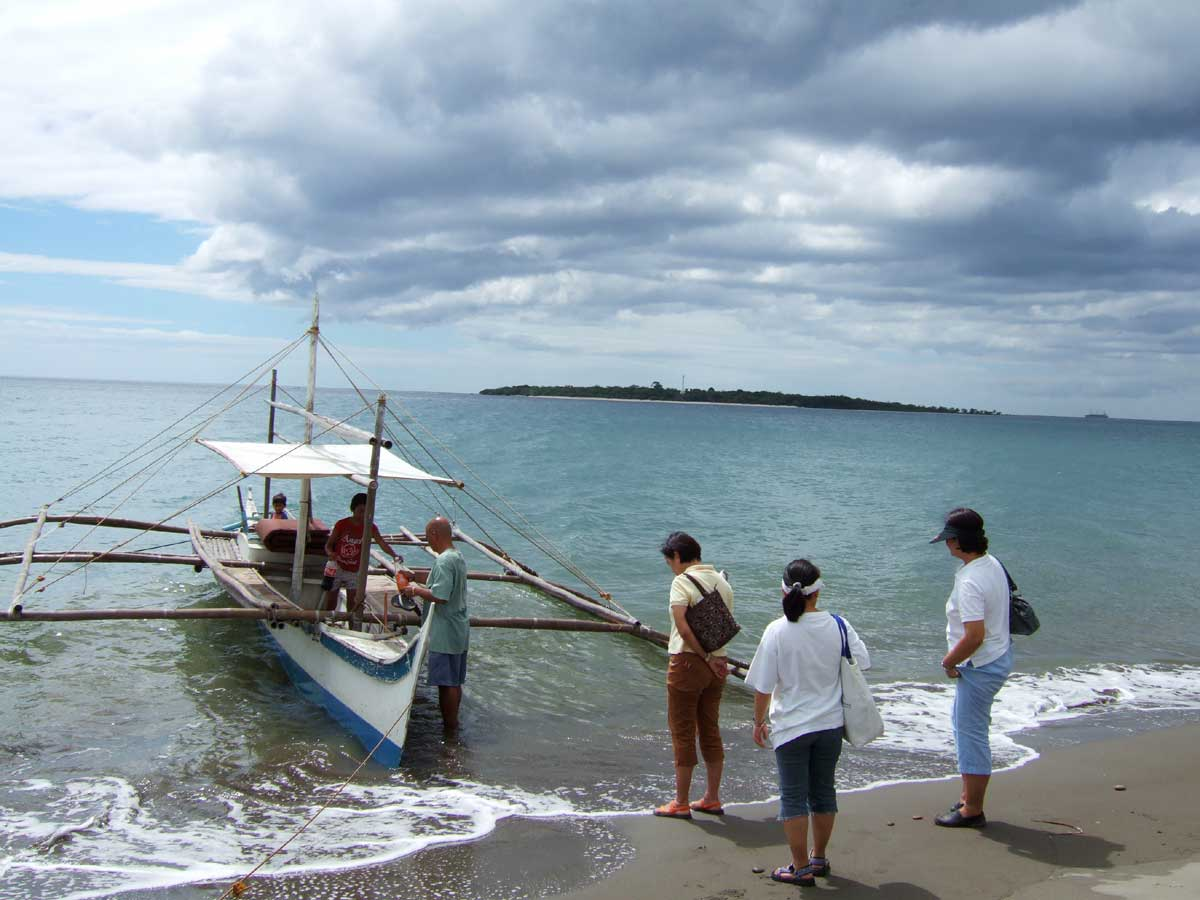 Leaving for Nogas Island (seen in distance) from Sira-an, Antique