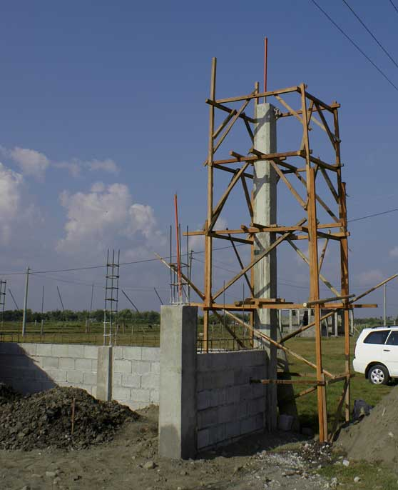 Tall post to receive electric power built into corner of fence