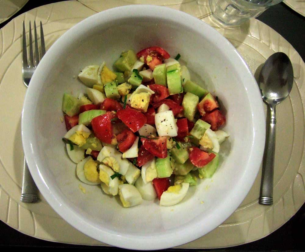 Tomato, egg, cucumber and cilantro salad
