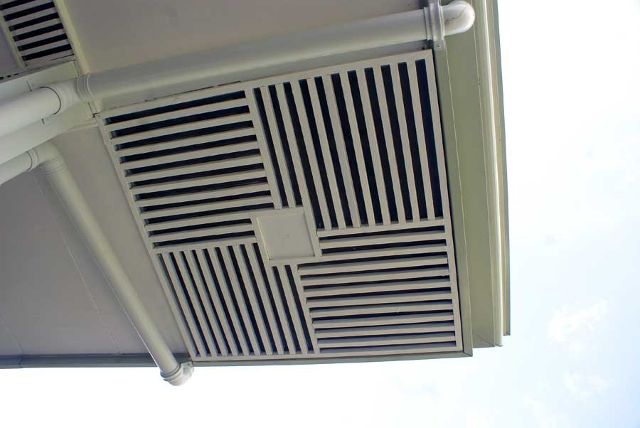 Soffit vent in each corner of the house