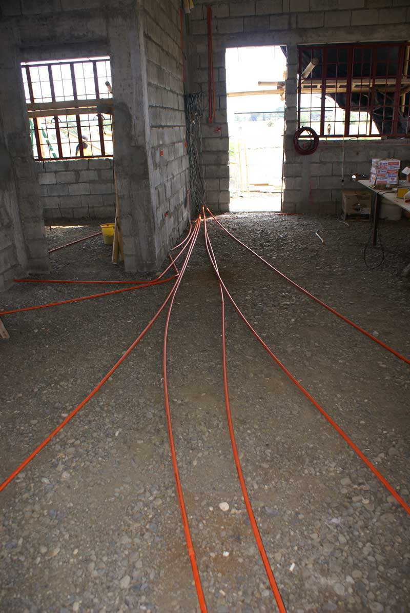 Conduit converge on panel box.  All will be buried in concrete floor.